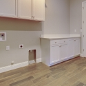 The upper and lower cabinets in the laundry room.