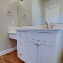 The vanity and one of the sinks, located to the left of the tub.