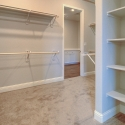 The large walk-through owner's closet, which connects to the laundry room.