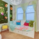 The third bedroom, shown staged as a garden-themed girl's bedroom.
