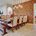 The dining area, with brick accent wall.