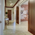 Looking down the hallway towards the front entry room. The study is shown to the right, with large sliding barn doors.