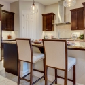 The kitchen, with large kitchen island and corner pantry.