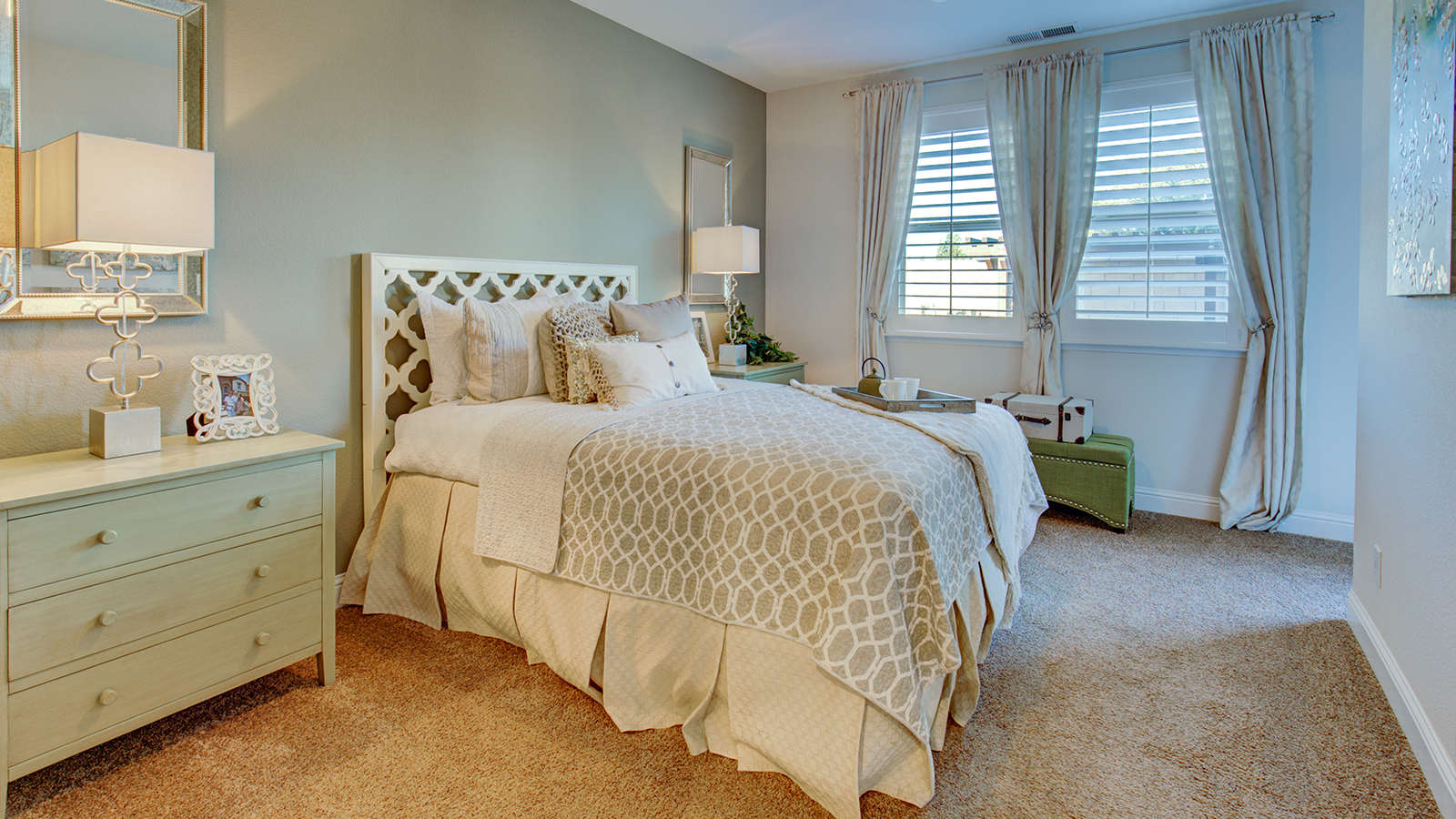 The lightweight blanket atop the bed in this guest suite is perfect for summer nights.