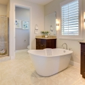 The owner's bathroom, featuring dual sinks, large soaking tub, and large step-in shower.