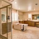 The owner's bath, with freestanding tub, dual sinks, vanity, and step-in shower.