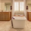 The dual sinks and freestanding tub in the owner's bath.