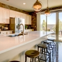 The kitchen, with extended kitchen island and sliding glass door leading to the covered patio.