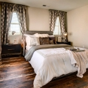The owner's bedroom, with distressed wood laminate flooring.