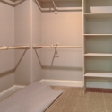 The large walk-in owner's wardrobe, with hanging rod and shelves.