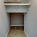 An under stair storage closet with hanging rod.