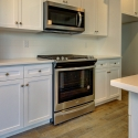 The included stainless steel Whirlpool microwave and oven.