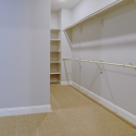 The spacious walk-in owner's wardrobe.