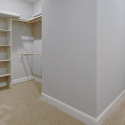 Additional view showing off the shelving and hanging rods in the owner's wardrobe.