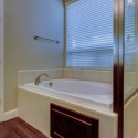 The tiled-in soaking tub in the owner's bath.