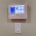 The pre-installed Honeywell security system controller.