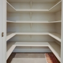 The large walk-in storage closet located at the laundry room.
