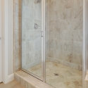 The tiled step-in shower in the owner's bath.