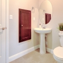 The downstairs powder bath, with medicine cabinet and linen closet.