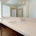 Close-up shot of the counter and dual sinks in the owner's bath.