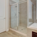 The tiled step-in shower at the owner's bath.