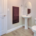 The powder bath, featuring a built-in medicine cabinet and linen closet.