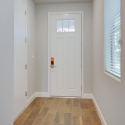 The white front entry door, as seen from the hallway.