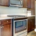 The included Whirlpool appliances in the kitchen.