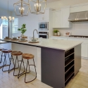 The kitchen, with large kitchen island, stainless steel appliances, and built-in wine rack.