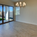 The dining nook, with large sliding glass door leading to the covered patio and landscaped backyard.