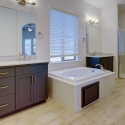 The owner's bath, with vanity, dual sinks, soaking tub, and large walk-in shower.