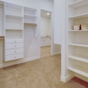 The large walk-through owner's wardrobe, which connects to the laundry room.
