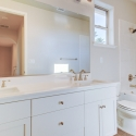 The second bathroom, with dual sinks.