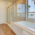 The tiled-in bathtub and step-in shower in the Owner's Bath.