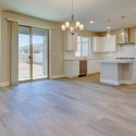 Wide angle view of the kitchen, dining area, and sliding glass door.
