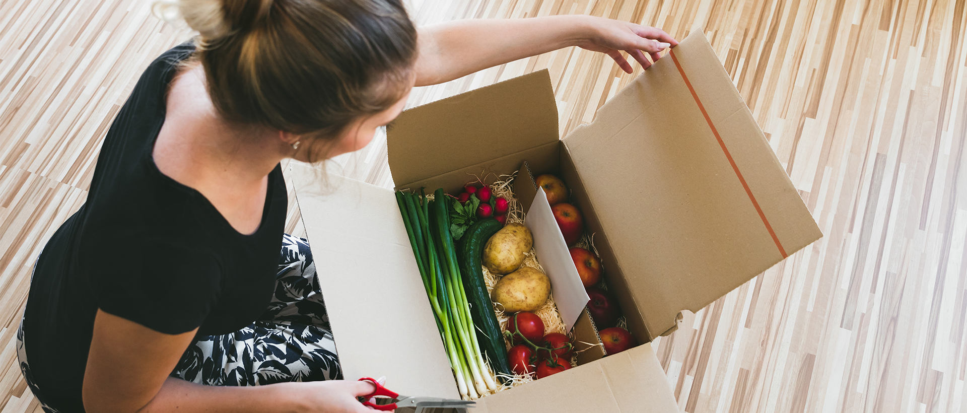 A woman unboxing her grocery delivery.