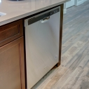 The included Whirlpool dishwasher, located at the kitchen island.