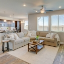 The spacious open-concept great room, which combines the living room, kitchen, and dining nook.