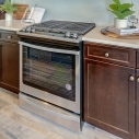 The included Whirlpool oven, with five-burner gas cooktop.