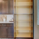 The kitchen pantry cabinet, located at the dining nook.