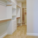 The large walk-in owner's wardrobe, with custom closet package.