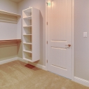 Additional view of the ample shelving and storage options in the owner's wardrobe.