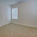 The third bedroom, with large sliding door closet.