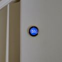 The pre-installed nest thermostat, located near the staircase.