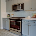 The included Whirlpool oven and above-range microwave in the kitchen.