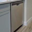 The included Whirlpool dishwasher at the kitchen island.