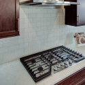 The included 5-burner gas cooktop.