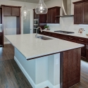 Additional view of the kitchen, showcasing the under cabinet lighting.
