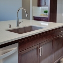 Closeup of the kitchen island, showcasing the upgraded bar pull hardware.