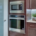 The included built-in microwave and oven in the kitchen.